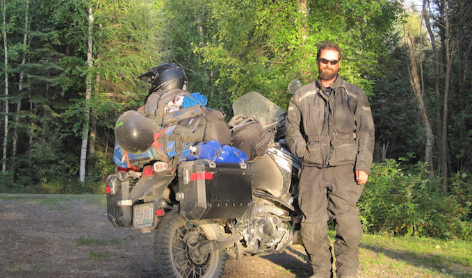 Mike Rutter and his fully loaded KLR in Blackstone Territorial Park during his solo ride of the Deh Cho Travel Connection.