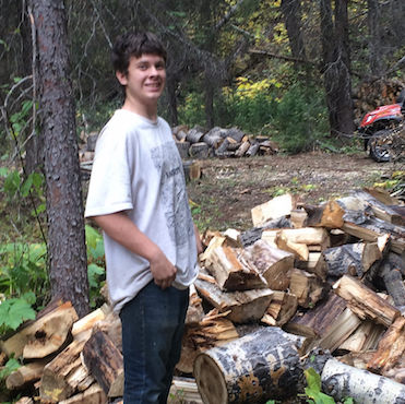 Sixteen-year-old Christian Hewlett helping his Uncle Cory set up mining camp near Perry Creek in B.C.