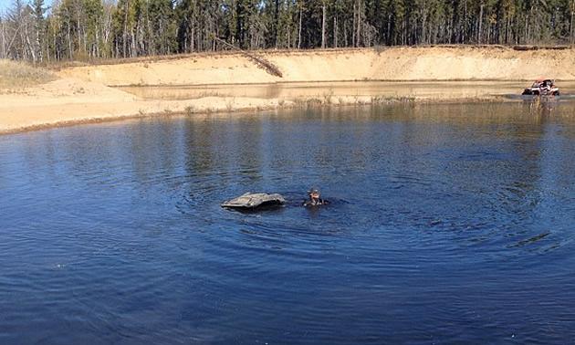 man atving in the water, in Prince Albert, Saskatchewan