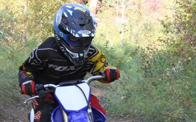kid riding a quad in Alberta