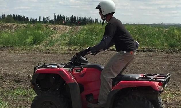 Rider on red ATV.