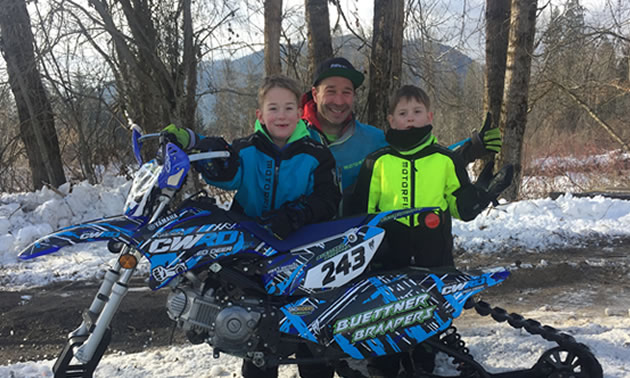 Advanced sled racer Jared Buettner (middle) and sons Korbin (left, age six) and Kohen (right, age five) also known as Little Ripper snowmobile racers.