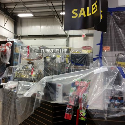 The inside of a store with plastic covering much of the merchandise
