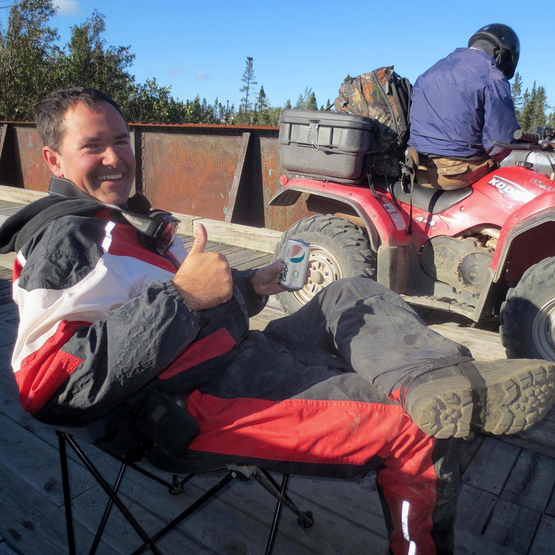 Two men are getting ready for an awesome ATV ride.