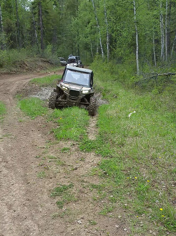One of the Ritchots' side-by-sides takes on a mud hole.