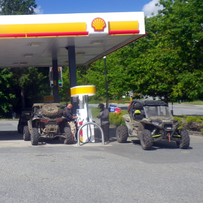 A group of UTVers fueling up at a Shell station.