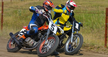 Photo of a person racing on a dirtbike