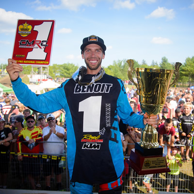Kaven Benoit holds up his No. 1 plate in front of fans at round 10 of nationals.