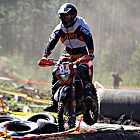 Person racing a dirt bike
