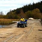 Photo of ATVers crossing a bridge