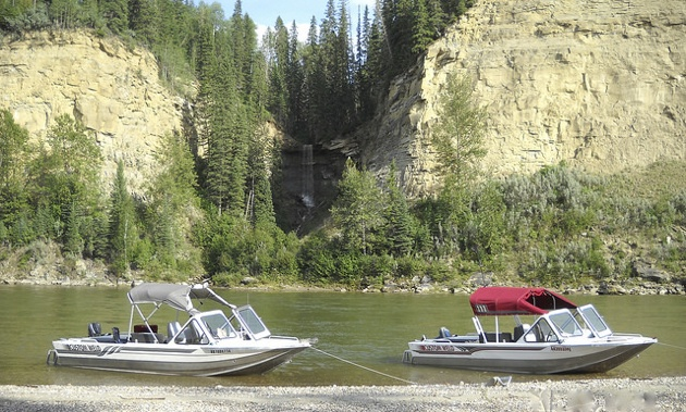 Pat and Lara Goertz's two river boats next to each other on the North Saskatchewan river.