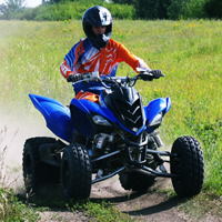 A young man on a blue quad.