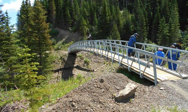 A 90-foot bridge in the South Kootenay pass was installed by members of the Crowsnest Pass Quad Squad.