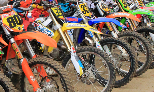 A row of colourful motorbikes.