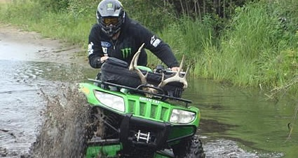 Tyler Manderscheid ATVing through mud