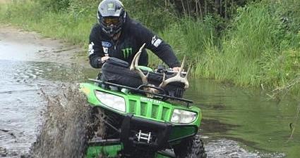 Tyler Manderscheid ATVing through mud