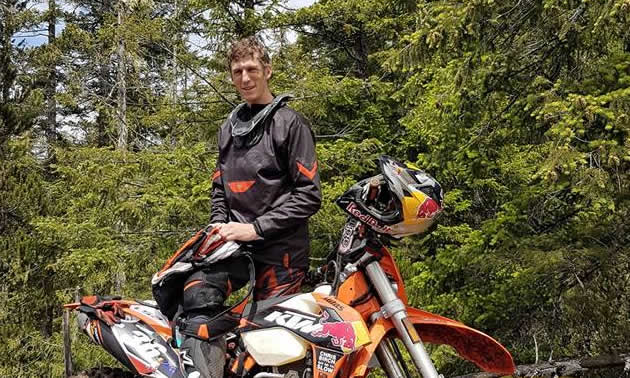 Chris Birch poses in Canada with his KTM 350 EXC.