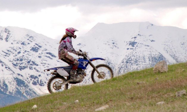 Claire Hatheway riding a TTR230 Yamaha, seven kilometres south of Wardner on the west shore of Lake Koocanusa.