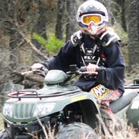 A kid riding an ATV.