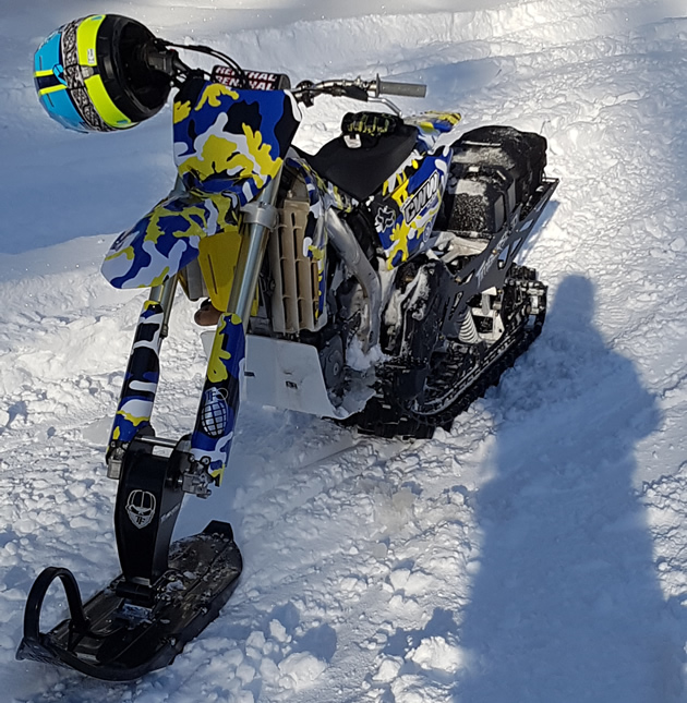 RMZ 450 outfitted with a Timbersled snow bike kit.