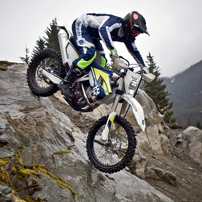 Cory Derpak navigates a steep and rocky descent on a Husqvarna enduro.