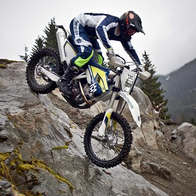 Cory Derpak navigates a steep and rocky descent on a Husqvarna enduro.