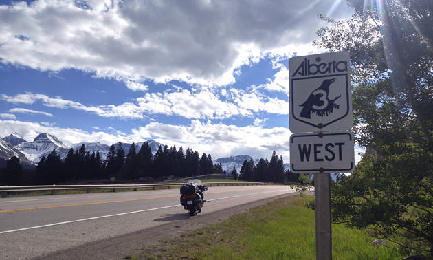 A motorcycle parked along the Crowsnest Highway 3 in Crowsnest Pass, Alberta.