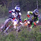 People racing dirt bikes