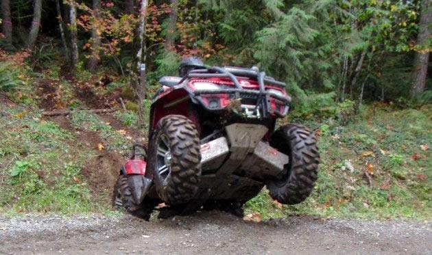 Popping a wheelie on an ATV.
