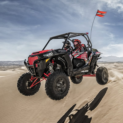 2018 Polaris Dynamix SxS flying through the dunes.