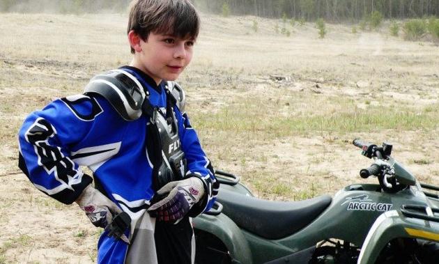 Tatum Evans riding ATV.