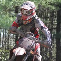 A young woman on a dirt bike.
