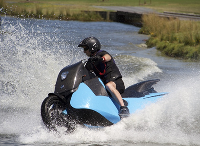A motorcycle riding on water.
