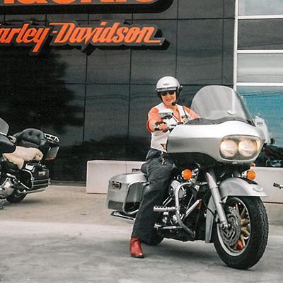 Gina sitting astride a Harley Road Glide.