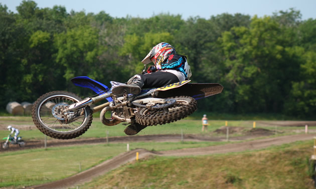A dirt rider whips a bike during practice for a race at Grunthal MX Track.