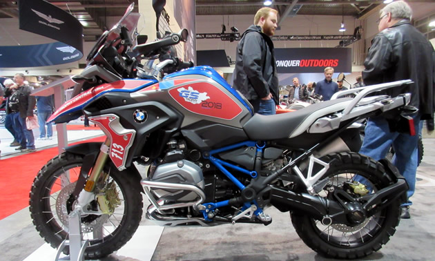Blue, red and black BMW adventure bike.