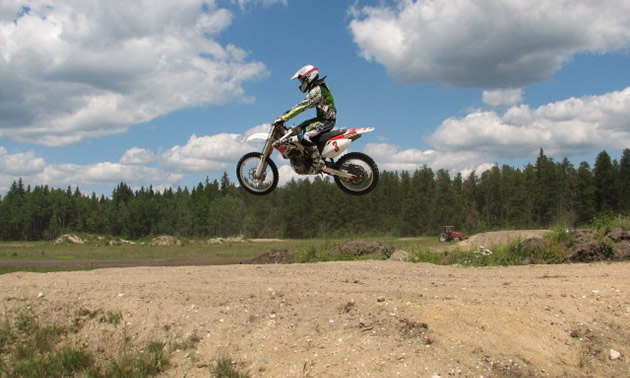 a guy riding on a dirt bike