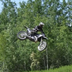 A man flies through the air on his dirt bike