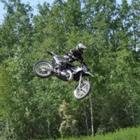 A man flies through the air on his dirt bike