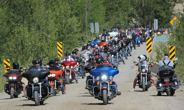 The road crossing the Horsethief Creek Bridge is packed with riders lining up for the Poker Run at the Memorial Rally.