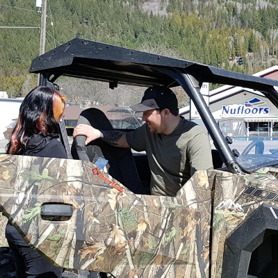 Jessica Vance helps a customer with his Polaris RZR.