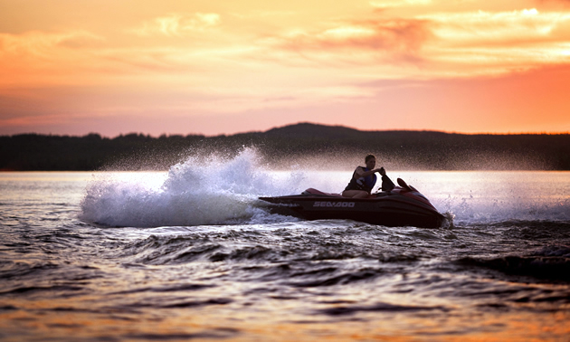 A person riding a jet ski on a lake in Saskatchewan.