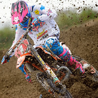 Kaven Benoit banking into a corner on his KTM.