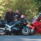 People standing beside their motorcycles