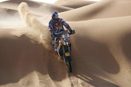 Kurt Caselli racing over a sand dune on his KTM.