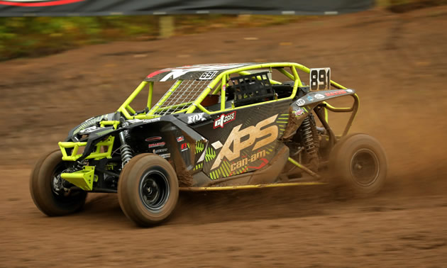 Can-Am Maverick X3 racing in the dirt.