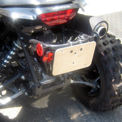 Licence plate mount on an ATV.