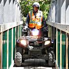 ATV going over a small bridge