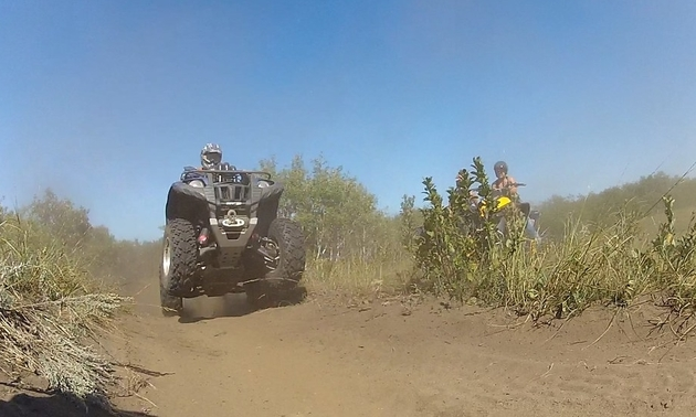 person on an ATV in Manitoba