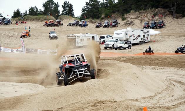 McBeth racing in the sand at UTV Takeover.